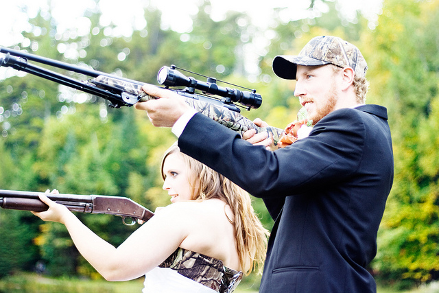 A shot of Julie and Mel with guns after the wedding.